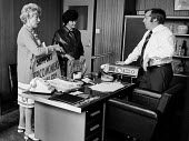 Women workers at TRICO on strike for Equal Pay talking to Mr Daniels, Director of General Express Services Ltd, in his office, Poplar, London. The women were angry that lorries were involved in strike... - Chris Davies - 1970s,1976,ACTIVIST,ACTIVISTS,adult,adults,anger,angry,argue,arguing,argument,at,AUEW,boss,bosses,breaker,breakers,breaking,campaign,campaigner,campaigners,campaigning,CAMPAIGNS,Cancer,CANCERS,communi