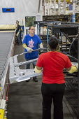 Sterling Heights, Michigan, Workers stacking car door panels at a Servo Tandem stamping press, Sterling Stamping Plant, Fiat Chrysler Automobiles - Jim West - 26-08-2016