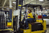 Sterling Heights, Michigan Women worker driving a forklift truck, moving car components that have been stamped and welded, Sterling Stamping Plant, Fiat Chrysler Automobiles - Jim West - African Americans,2010s,2016,African American,AUTO,auto parts,AUTOMOBILE,AUTOMOBILES,automotive,Automotive Industry,BAME,BAMEs,BEMM,Black,BME,bmes,capitalism,car,Car Industry,carindustry,cars,componen