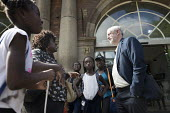 Jeremy Corbyn talking to a mother and children outside the railway station, leadership election rally, Hanley, Stoke on Trent - John Harris - 01-09-2016