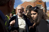Jeremy Corbyn being interviewed by media, leadership election rally, Hanley, Stoke on Trent. Press officer Nial Sadoko (r) - John Harris - 2010s,2016,BAME,BAMEs,BEMM,BEMMs,Black,BME,bmes,campaign,campaigning,CAMPAIGNS,communicating,communication,conversation,conversations,dialogue,discourse,discuss,discusses,discussing,discussion,diversi