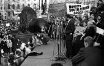 Tennyson Makiwane, ANC, speaking. Rally launching The Boycott Movement Month of Action against Apartheid South Africa, Trafalgar Square, London 1960 - Alan Vines - 1960,1960s,AAM,activist,activists,Africa,against,Anti Apartheid Movement,apartheid,BAME,BAMEs,bigotry,black,BME,bmes,boycott,boycotting,campaign,campaigner,campaigners,campaigning,CAMPAIGNS,DEMONSTRAT