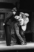 A Pound On Demand, written by Sean O'Casey, Mermaid Theatre, London, 1967. Dermot MacDowell as The Policeman with Jack Macgowran as Sammy and Barry Keegan as Jerry. - Patrick Eagar - 1960s,1967,ACE,act,acting,actor,actors,adult,adults,Arts,Barry Keegan,cities,city,Culture,Dermot MacDowell,drama,DRAMATIC,entertainment,force,Jack Macgowran,Jerry,London,male,man,men,OFFICER,OFFICERS,
