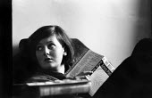 Young woman reading The Bell Jar by Sylvia Plath, 1967 London, when it was first published under her real name. - Patrick Eagar - 06-04-1967