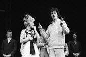 Lead actress Barbara Windsor with the director, Robin Phillips, Sing A Rude Song, The Greenwich Theatre, 1970. A play based on the life of Marie Lloyd, written by Ned Sherrin and Caryl Brahms. - Patrick Eagar - 1970,1970s,ACE,act,acting,actor,actors,actress,actresses,adult,adults,Arts,Barbara Windsor,cities,city,Culture,directing,director,directors,drama,DRAMATIC,entertainment,FEMALE,male,man,Marie Lloyd,MAT