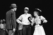 Lead actress Barbara Windsor as Marie Lloyd, with Dennis Quilley, bowler hat, and Maurice Gibb, Sing A Rude Song, The Greenwich Theatre, 1970. A play based on the life of Marie Lloyd, written by Ned S... - Patrick Eagar - 1970,1970s,ACE,act,acting,actor,actors,actress,actresses,Arts,Barbara Windsor,cities,city,Culture,Dennis Quilley,drama,DRAMATIC,entertainment,FEMALE,hat,hats,male,man,Marie Lloyd,Maurice Gibb,men,peop