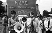 Jeremy Corby MP speaking at a rally of NUPE members striking against privatisation at Barking Hospital, 1985. Behind him are fellow Labour MPs Jo Richardson and Clare Short - Stefano Cagnoni - 1980s,1985,against,banner,banners,campaign,campaigning,CAMPAIGNS,disputes,FEMALE,Hospital,HOSPITALS,INDUSTRIAL DISPUTE,Jeremy Corbyn,Labour,Labour Party,Left,left wing,Leftwing,male,man,member,member
