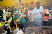 Blockade of truckers and farmers demanding Calais Jungle refugee camp closure joined by Port of Calais dockers with motorway barbecue, France. - Jess Hurd - 05-09-2016