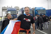Edwin Wagensveld, leader Pegida Netherlands supporting blockade of truckers and farmers demanding Calais Jungle refugee camp closure joined by Port of Calais dockers. France. - Jess Hurd - 05-09-2016