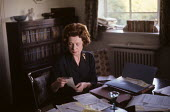 Barbara Castle, Minister for Overseas Development in the Harold Wilson Labour Government, reading press cuttings at home, London, 1964. - Romano Cagnoni - 1960s,1964,Barbara Castle,Castle,communicating,communication,Development,FEMALE,Government,home,Labour Party,London,Minister,MP,MPs,people,person,persons,POL,political,politician,politicians,politics,
