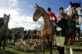 Huntsmen from the Percy Hunt Alnwick, Northumberland, 19/2 2005. The day after the hunting ban. - Mark Pinder - 2000s,2005,AFFLUENCE,AFFLUENT,animal,animal animals,animals,blood sports,Bourgeoisie,canine,castle,class,CLJ law,country,countryside,dog,dogs,domesticated ungulate,domesticated ungulates,elite,elitism