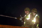 Soldiers manning a green goddess attending a minor fire at an industrial site in North Shields, Tyne and Wear. - Mark Pinder - 24-11-2002