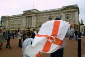 An Orangeman with Orange Order flag outside Buckingham Palace - Mark Pinder - 2000s,2002,ACE culture,death,DEATHS,died,Flag flags,loyalism,loyalist,loyalists,Monarchist,Monarchists,Monarchy,mortality,MOURNER,MOURNERS,Mourning,Orange,Orangeman,outside,queen mother,Royal family,R