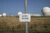 A sign proclaiming the use of closed circuit television cameras, (CCTV) on the perimeter fence at the Menwith Hill listening base, North Yorkshire. 22/3 2003. - Mark Pinder - RAF Menwith Hill,2000s,2003,Air force,air forces,Airforce,armed forces,attention,attentive,camera,cameras,cctv,closed,closing,closure,closures,communicating,communication,Counter Terrorism,crime,crime