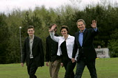 Tony Blair with wife Cherie and sons Euan and Nicky walk the short distance from the Prime Ministers Constituency home to their local polling station 5/5 2005, the Day of the 2005 General Election. - Mark Pinder - 2000s,2005,election elections,general,home,labour party,local,POL politics,station,STATIONS