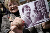 A supporter of Tony Blair, Lena Devine, attending his resignation timetable announcement rally holds up a photo of herself with Blair taken in sedgefield Village in 1984, the year after he became memb... - Mark Pinder - 2000s,2007,Parliament,POL politics,rallies,rally,resignation,supporter,TIME,timetable,Village,VILLAGES,woman women