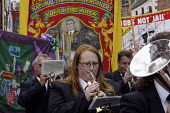 Brass band and Yorkshire Area miners banner, 2009 Durham Miners Gala, Durham 2009 - Mark Pinder - 2000s,2009,ACE arts culture & entertainment,ace culture,activist,activists,against,band bands,banner,banner banners,BANNERS,CAMPAIGN,campaigner,campaigners,CAMPAIGNING,CAMPAIGNS,cornet,County Durham,D