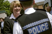Jacqui Smith talking to a policeman on a visit to Trimdon Grange in County Durham to support Phil Wilson the Labour candidate in the Sedgefield by election. 16/7 2007. - Mark Pinder - 2000s,2007,candidate,CANDIDATES,clj,communicating,communication,conversation,dialogue,discuss discussing,force,labour party,MP,OFFICER,OFFICERS,POL politics,POLICE,police officer officers,policeman,po