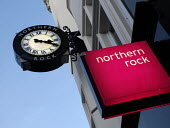 The Northern Rock Clock and sign outside the Northumberland Street, Newcastle, branch of the bank - Mark Pinder - 2000s,2007,bank,banking,banking crisis,banks,buy,buyer,buyers,buying,commodities,commodity,credit crunch,DOWNTURN,EBF economy business & finance,finance,FINANCIAL,financial crisis,goods,mortgage mortg