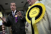 Outside the UKIP campaign HQ with members of the Monster Raving Loony Party. UKIP leader Nigel Farage campaigning during the 2013 South Shields by-election, Tyne and Wear, UK, 30/4 2013 - Mark Pinder - 2010s,2013,CAMPAIGN,campaign campaigning,campaigning,CAMPAIGNS,candidate candidates,democracy,election elections,eurosceptic,Euroscepticism,eurosceptics,leader,mp mps,Outside,pol politics,rosette,SHIE