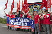 Steve Turner with Unite Community members recruiting Sports Direct workers Shirebrook, Derbyshire - John Harris - 2010s,2016,banner,banners,communities,Community,employment,employment agency,flag,flags,leaflet,LEAFLETING,leaflets,leafletting,male,man,member,member members,members,men,minimum wage,Nottingham,organ