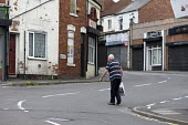 Closed shops, Shirebrook, Derbyshire - John Harris - 2010s,2016,adult,adults,age,ageing population,bought,buy,buyer,buyers,buying,closed,closed down,closing,closure,closures,commodities,commodity,communities,community,consumer,consumers,cross,crosses,cr