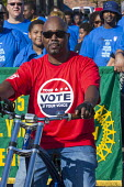 Detroit, Michigan, Members of the UAW marching in the Labor Day parade, campaigning for members to turn out to vote in the 2016 presidential election. - Jim West - ,2010s,2016,AFL CIO,African American,African Americans,BAME,BAMEs,BEMM,BEMMs,black,BME,bmes,campaign,campaigning,CAMPAIGNS,cities,City,DEMOCRACY,Democratic Party,Democrats,Detroit,diversity,election,e