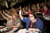 Unison delegates voting at TUC conference Brighton. - Jess Hurd - 2010s,2016,Conference,conferences,Congress,delegate,delegates,delegation,democracy,female,Hands up,member,member members,members,people,person,persons,Trade Union,Trade Union,Trade Unions,Trades Union