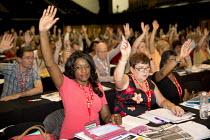 UNISON delegates voting TUC conference Brighton. - Jess Hurd - 2010s,2016,BAME,BAMEs,BEMM,black,BME,bmes,Conference,conferences,Congress,delegate,delegates,delegation,democracy,diversity,ethnic,ethnicity,female,Hands up,member,member members,members,minorities,mi