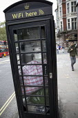 Bags left by a homeless person in a telephone and wifi box, Piccadilly, Central London. - Jess Hurd - 17-09-2016