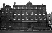 The closed East End Maternity Hospital, Tower Hamlets, one of the poorest boroughs in the UK, 1976. The Hospital was closed in 1968. - Angela Phillips - 12-02-1976