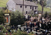 Well Dressing ceremony in 1949 in the small village of Stoney Middleton in the Peak District of Derbyshire. Well Dressing is a Christian tradition developed originally from pagan custom of making sacr... - Elisabeth Chat - 1940s,1949,ACE,ACE culture,bands,belief,brass,brass band,bucolic,ceremonies,ceremony,christian,christianity,christians,clergy,conviction,country,countryside,Culture,custom,customs,faith,festival,festi