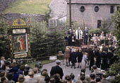 Well Dressing ceremony in 1949 in the small village of Stoney Middleton in the Peak District of Derbyshire. Well Dressing is a Christian tradition developed originally from pagan custom of making sacr... - Elisabeth Chat - 1940s,1949,ACE,ACE culture,bands,belief,brass,brass band,bucolic,ceremonies,ceremony,christian,christianity,christians,clergy,conviction,country,countryside,Culture,custom,customs,faith,FEMALE,festiva