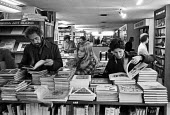 Customers browsing, Foyles Bookshop, Charing Cross Road, London, 1975 - John Sturrock - 1970s,1975,book,books,bookseller,booksellers,bookshelves,bookshop,bookshops,bought,browse,browsing,business,buy,buyer,buyers,buying,cities,City,commodities,commodity,communicating,communication,consum