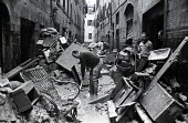 Clearing up, Florence Floods, Italy, 1966. The floods in Florence in early November 1966 were the worst in over five hundred years and resulted in the loss of over 100 Florentine lives as well as dama... - Romano Cagnoni - 1960s,1966,ARTEFACT,artefacts,BAD,BOOK,books,cities,City,clearance,CLEARENCE,clearing,clearing away,damage,damaged,damp,dampness,DIA,disaster,disasters,EXTREME,flood,flood damage,flooded,flooded stree