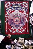 Durham Miners Gala, 1983. Miners and their families march on the 100th Anniversary of the Durham Miners Gala. The Eden Lodge pit banner. - Stefano Cagnoni - 1980s,1983,ACE,anniversary,banner,banners,Big Meeting,boy,BOYS,brass,brass band,centenary,child,CHILDHOOD,children,County Durham,Culture,Durham Miners,Durham Miners Gala,juvenile,juveniles,kid,kids,lo