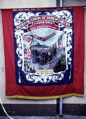 Durham Miners Gala, 1983. Miners march on the 100th Anniversary of the Durham Miners Gala. The Boldon pit banner. - Stefano Cagnoni - 1980s,1983,ACE,anniversary,banner,banners,Big Meeting,centenary,County Durham,Culture,Durham Miners,Durham Miners Gala,lodge banner,member,member members,members,MINER,miner miners,Miners,MINER'S,NUM,