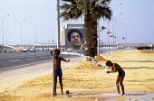 Tripoli 1984, 15th Anniversary of the coup that put Muammar Gaddafi in control of Libya, later renaming it the Socialist Peoples Libyan Arab Jamahiriya. - Stefano Cagnoni - 1980s,1984,African,Africans,Anniversary,arab,arabic,arabs,boy,boys,child,CHILDHOOD,children,Colonel Gaddafi,cooling off,Gaddafi,Jamahiriya,juvenile,juveniles,kid,kids,leader,Libya,Libyan,Libyans,male,