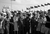 Demonstration in support of Muammar Gaddafi, Tripoli 1984 on the 15th Anniversary of the coup that put him in control of Libya, later renaming it the Socialist Peoples Libyan Arab Jamahiriya. Women so... - Stefano Cagnoni - 1980s,1984,activist,activists,African,Africans,Anniversary,arab,arabic,arabs,Armed Forces,army,CAMPAIGN,campaigner,campaigners,CAMPAIGNING,CAMPAIGNS,DEMONSTRATING,demonstration,DEMONSTRATIONS,female,f