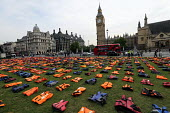 Graveyard of life jackets, 2500 laid out in Parliament Square, a tribute to thousands of refugees who have drowned over the past year trying to cross the Mediterranean, London - Jess Hurd - 2010s,2016,activist,activists,CAMPAIGN,campaigner,campaigners,CAMPAIGNING,CAMPAIGNS,cemeteries,cemetery,crisis,death,deaths,DEMONSTRATING,Demonstration,DEMONSTRATIONS,Diaspora,died,displaced,drowned,f