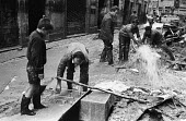 Clearing up, Florence Floods, Italy, 1966. The floods in Florence in early November 1966 were the worst in over five hundred years and resulted in the loss of over 100 Florentine lives as well as dama... - Romano Cagnoni - 1960s,1966,ARTEFACT,artefacts,BAD,BOOK,books,cities,City,clearing,clearing away,damage,damp,dampness,dealing,DIA,disaster,disasters,EXTREME,flood,flood damage,flooded,flooded streets,flooding,floods,F
