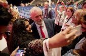 Jeremy Corbyn talking to supporters, Labour Party conference Liverpool. - Jess Hurd - 2010s,2016,Asian,Asians,BAME,BAMEs,BEMM,black,BME,bmes,CAMERA,camera phone,cameras,communicating,communication,conference,conferences,conversation,cultural,dialogue,diversity,ethnic,ethnicity,FEMALE,L