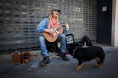Busking on the streets of Sheffield. Sheffield, South Yorkshire - Connor Matheson - 2010s,2016,animal,animals,busker,buskers,busking,canine,cities,City,dog,dogs,jobless,jobseeker,jobseekers,Leisure,LFL,LIFE,Lifestyle,male,man,Marginalised,melody,men,music,MUSICAL,musical instrument,m
