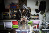 An event promoter counts his cash at the Golden Harvest headshop. Sheffield city center, South Yorkshire. - Connor Matheson - 14-05-2016