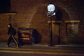 Man in a tracksuit walking past a road sign under repair, Sheffield City Centre, South Yorkshire - Connor Matheson - 2010s,2016,bin,bins,cities,City,City centre,communicating,communication,EBF,Economic,Economy,highway,light,lighting on,lights,male,man,men,night time,pedestrian,pedestrians,people,person,persons,REFUR