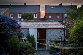 Sun setting inbetween houses. Ryhill, Wakefield, West Yorkshire - Connor Matheson - 2010s,2016,backyard,cities,City,Council Housing,Council Services,Council Housing,Council Services,door,doors,EBF,Economic,Economy,evening,garage,garages,garden,gardens,house,houses,Housing,Housing Est