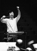 Japanese conductor Seiji Ozawa, Royal Festival Hall, London 1967 - Patrick Eagar - 1960s,1967,ACE,Arts,baton,batons,cities,city,classical,classical music,composer,concert,concerts,conducting,conductor,conductors,Culture,Festival,FESTIVALS,Japanese,London,male,man,melody,men,music,MU