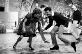 Professional dancer Lionel Blair dancing The Twist with other dancers London 1964 - Romano Cagnoni - 1960s,1964,ACE,Arts,Blair,cities,city,Culture,dance,dance craze,dancer,dancers,dancing,ENJOYING,enjoyment,entertainment,expression,FEMALE,fun,glitter,Lionel Blair,London,male,man,melody,men,movement,m