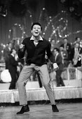 Professional dancer Lionel Blair dancing The Twist with other dancers London 1964 - Romano Cagnoni - 1960s,1964,ACE,Arts,Blair,cities,city,Culture,dance,dance craze,dancer,dancers,dancing,ENJOYING,enjoyment,entertainment,expression,fun,glitter,Lionel Blair,London,male,man,melody,men,movement,music,MU