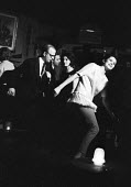 Dancing The Twist in a nightclub London 1964 - Romano Cagnoni - 1960s,1964,ACE,Arts,cities,city,club,clubs,Culture,dance,dance craze,dance steps,dancer,dancers,dancing,ENJOYING,enjoyment,entertainment,expression,FEMALE,fun,glitter,London,male,man,melody,men,moveme